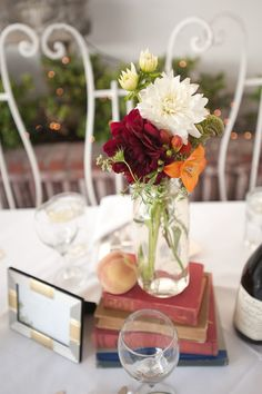 Great idea for a bookclub dinner... using vintage books as centerpieces - love it!