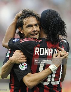 AC Milan's forward Filippo Inzaghi (L) celebrates with teammate Brazilian Ronaldinho after scoring against Sampdoria during their Italian Serie A match on October 19, 2008 at San Siro Stadium in Milan. AC Milan defeated Sampdoria 3-0.