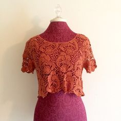 Coral Crochet Crop Top So cute & fun! In great shape. Requires some sort of shirt underneath but would be adorable  over a bandeau, a tank, swimsuit or maxi dress!  Higher in the front than the back. Please use the offer button & check out my closet for bundle deals. No trades please! Forever 21 Tops Crop Tops