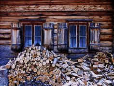 stockpiling firewood next to a wood house