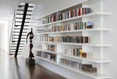 home library design with built in bookcases and shelves