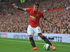 Manchester United's Argentinian defender Marcos Rojo crosses the ball during the English Premier League football match between Manchester United and Queens Park Rangers at Old Trafford in Manchester, north west England on September 14, 2014.