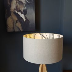 This beautiful silhouette lampshade is made using Cole & Sons' Iconic The Woods wallpaper on the inside and a soft Linen on the outside of the lampshade. Allowing the print on the inside of the shade to appear once the light is turned on. Love Frankie lampshades are made using a high quality flame retardant PVC and an extensive range of sumptuous fabrics. Our frames are made with a 39mm European ring fitting with a 29mm UK reducing ring already fitted that will pop in and out if need...