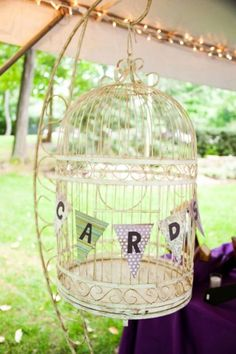 Love the idea of putting the cards in a birdcage. - ADR - with you having a bird we could find an old style cage and do this....it makes it personal