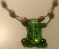 Beaded Necklace with Glass Frog Charm by IndigoCrush on Etsy
