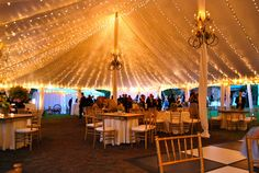 This idea for tent lighting is from:  http://imgkid.com/wedding-tent-lights.shtml