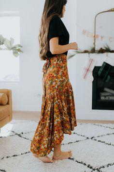 DETAILS: - Mustard wrap midi skirt - Floral detailing - Ruffled hem - 100% rayon MEASUREMENTS (measured with garment laying flat): - S: Waist: 32 cm, Hip: 36 cm, Length: 77 cm - M: Waist: 38 cm, Hip: 42 cm, Length: 78.5 cm - L: Waist: 42 cm, Hip: 45 cm, Length: 80 cm