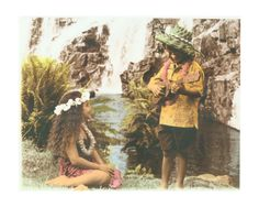 Hawaiian boy and girl at waterfall