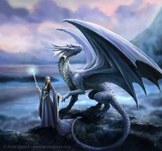 Reminds me a lot of El with the staff and smaller dragon, just change the hair colour and dragon a bit.