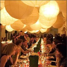 create an intimate feeling in a giant space by filling it with large bamboo paper lanterns and light.