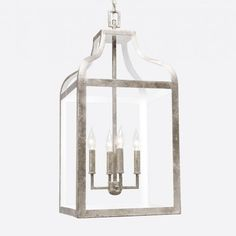 The graphic look of our Roscoe gives a fresh feel to its traditional lantern shape. Two metalized finishes contrast strikingly with a white interior. Achieve vintage and modern appeal in one chandelier. 4 Lights  Finish: Textured Silver Leaf Metal (Shown), Textured Gold Leaf Metal