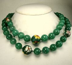 Chinese JADE Green Peking Glass w Cloisonne Enamel Bead Focal Necklace, Hand Knotted Beauty, 1980s, Traditional, No Catch  Nice Hade Color--EVEN Tone, sorry the lights made the beads look all different green tones, but it is one jade green color peking glass beads ..all size 3/8 ( 10mm) This Asian Traditional Green jade GLASS necklace is 31 long ( 78.74cm ) The butterfly and flower cloisonne enamel beads are 1/2 ( 13mm ) It is a lovely color jade green glass and very classy Traditional…