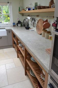 This handmade kitchen in West London was made complete with the addition of our cast in situ polished concrete worktops. The work surface was 65mm thick and in a natural grey colour. The client required an overhang on the island and a knockout for a large butchers block as well as knockouts for hob, sink and tap.