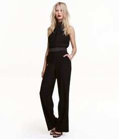 Black. Jumpsuit in woven fabric. Narrow-cut at top with pleats, halter neck, and satin stand-up collar with hook-and-eye fasteners at back. Narrow satin