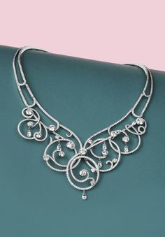 Boodles 'Sweet Pea' necklace with signature diamond-set swirls and diamond briolettes.