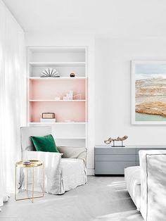 a pink shelf on a bookcase