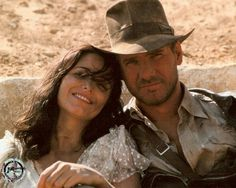 Harrison Ford as Indiana Jones and Karen Allen as Marion Ravenwood in Indiana Jones: Raiders of the Lost Ark - One of the best on-screen couples. Henry Jones Jr, Harrison Ford Indiana Jones, Indiana Jones Films, Indiana Jones Jacket, Movie Stars, Movie Tv, Little Dorrit, Image Film, Tv Couples