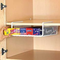 Great for: Kitchens, offices, bathrooms Best thing: Fits in space that often goes otherwise unused How much: $8-$12 depending on size Where to find it: Amazon.com Under the Shelf Wrap & Bag Holder Kitchen Hanging Basket Storage Bin Hampton Direct,http://www.amazon.com/dp/B00E0J5BN8/ref=cm_sw_r_pi_dp_07Umtb1KRVRFZPF4