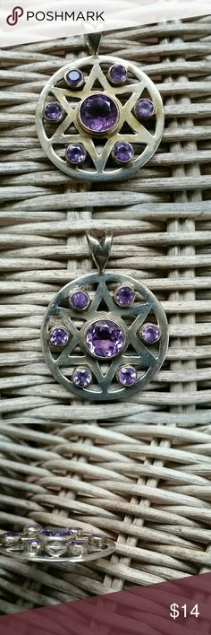 Star of David with purple stones pendant Pendant features star of David with 6 small stones and one large stone in the middle.  Measures approximately 1 and a quarter inches in diameter.  Does not come with necklace. Jewelry Necklaces