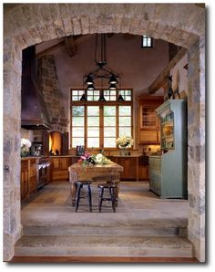 Love this kitchen… the floors, the brick, the oven, everything!
