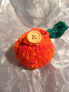 Great little knitted Orange cosy with a wooden button close. Holds one small Orange or a regular sized apple. Cosy, Crochet Earrings, Orange, Handmade, Hand Made, Handarbeit