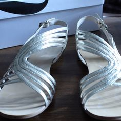 NWOT Nine West Short Silver Wedges Nine West BRAND NEW wedges. Super cute!! The shoes don't have tags, because they never came with tags but you can tell they're brand new. Nine West Shoes Sandals