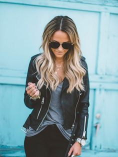 Black leather jacket with a grey t & black denim jeans