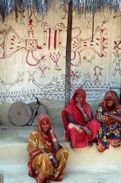 Nepalese painter Ranibati Mukhiya (far right) sitting with relatives and neighbors next to her wall painting, Nepal, 1989. Photograph courtesy of Claire Burkert. On view August 6, 2012 to May 15, 2013 at Carnegie Museum of Natural History.