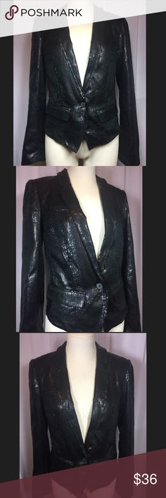 Free People sequined blazer Excellent condition!! No missing sequins. Front longest is 23 inches at peak. Back falls shorter at 19 inches. Shell and lining are both 100% polyester. Smoke free and pet free home! Free People Jackets & Coats Blazers