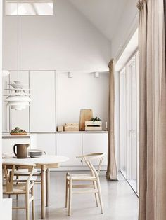 Beautiful-and-Harmonious-Scandinavian-home-in-natural-shades | kitchen | pale pink linen curtains | neutral kitchen diner