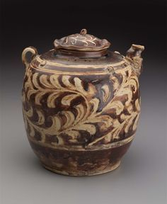 Ewer Vietnam, Tran dynasty, 13th–14th century, Stoneware with brown and ivory glazes, incised and painted decoration, 19 x 18 cm MFA, 2002.743a-b