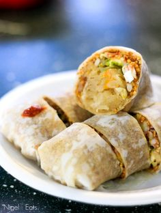 Singapore Street Food - Stew shredded turnip wrap with hard boiled eggs, chili, sweet soya sauce and minced peanuts or otherwise know as Poh Piah
