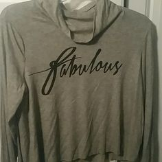 Long sleeve crop top Long sleeve crop top that reads fabulous. Never worn still has tags on it. Tops Tees - Long Sleeve