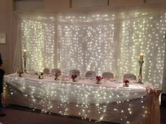 Top table at The White Hart Hotel by Fairytales - http://www.fairytalesgrimsby.co.uk #Wedding #toptable #lightcurtain #Lincolnshire #BailgateWed