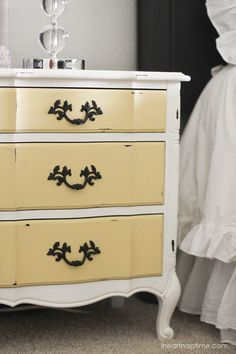 The Yellow Drawers on this dresser are so pretty! Yellow White Painted Dresser #YellowDresser #PaintedFurniture