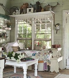 Shabby sunroom. Shelves above window