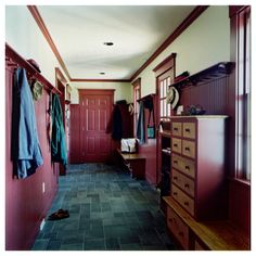 Mudroom with red beadboard and pegs - Vermont Vernacular