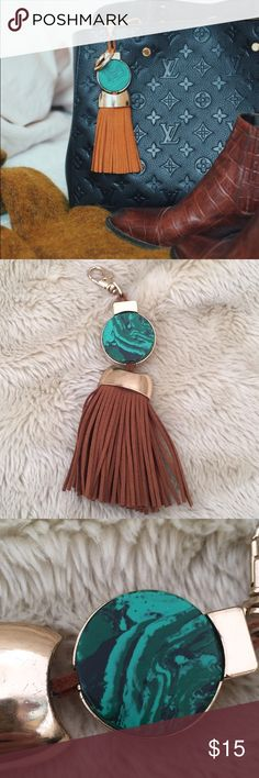 ZARA Teal Purse Charm with GENUINE suede tassel Elevate your purse game with this ZARA bag charm! Gold-tone hardware, tan suede tassel, and teal marble stone. Can also be worn as a keychain. MSRP: $20 + tax.  USED CONDITION: Displayed this bag charm on my carry-on for about a month. Felt like it was getting dinged up so I removed it and it's been lying in a drawer ever since. Hardware shows signs of wear but tassel is in excellent condition.  Smoke and pet-free home!  I often adjust my…