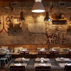 Formerly a lumber warehouse in the heart of NOHO, this urban space has been transformed into an italian restaurant and deli. serving sandwiches towards the front and breakfast, lunch, and dinner at the rear, the space is raw, romantic, and full of texture. Il Buco Alimentarie Vineria