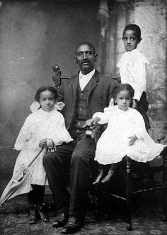 African American Man and Children by Black History Album, via Flickr