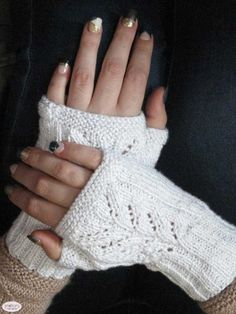 Free knitting pattern for fingerless mitts with a simple lace motif on the hand. Uses a thin metallic yarn held with the main yarn to give it some bling.