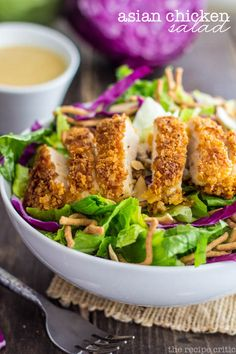 Asian Chicken Salad at http://therecipecritic.com Crisp oriental greens, topped with crunchy chicken, toasted almonds and crispy chow mien noodles tossed with a light and delicious oriental vinaigrette! A copycat to Applebees that is amazing!