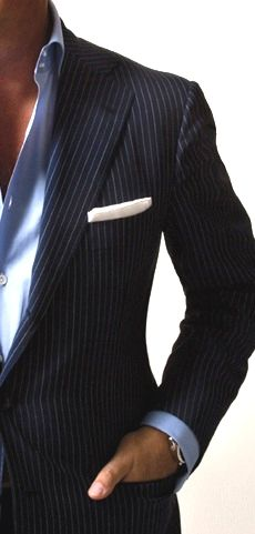 Blue pinstriped suit, blue dress shirt and white pocket square