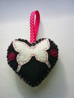 Black felt, pink and white butterfly heart decoration