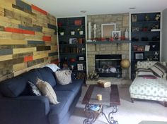 Wood pallet wall! Love the orange, but will white wash the orange slats more... for subtlety.