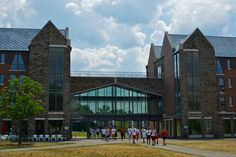 Cornell Right Now: Cornell Sports School attendees cross the plaza between Kay and Bauer halls on North Campus with Helen Newman Hall in the background. Photo by Joe Wilensky