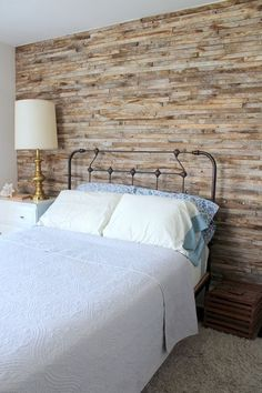 "In less than a day, Bright installed narrow strips of wood, called laths, that he had accumulated during the renovation process to create a rustic wall in the guest bedroom. ""You can't beat free materials,"" he says."