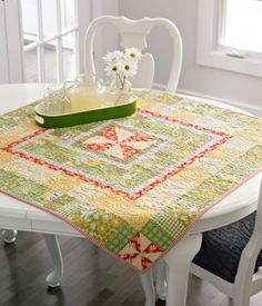 A simple Pinwheel block is quite a star when it's surrounded by multiple borders—pieced and plain.  Free pattern from All People Quilt
