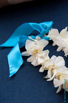 A beautiful ribbon can simply transform a lei. Milan Event Floral and Mec Images