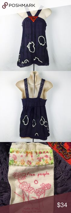 """Free People ink blot beaded tank top size 0 This is a gorgeous Free People ink blot print tank. Size 0. Has a beaded orange triangle on the front. Made of linen and cotton. Bust 28"""" length 29"""". Ties in the back for a better fit. Free People Tops Tank Tops"""